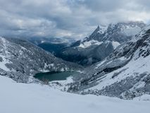 Turquoise colored alpine lake in winter stock photo