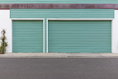 Turquoise colored garage door Royalty Free Stock Images