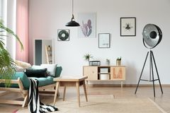 Warm living room with lamp Stock Images