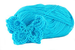 Turquoise crochet butterfly. And the thread royalty free stock image
