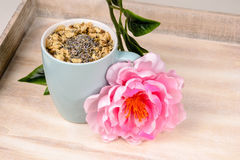 Turquoise cup of tea with flower on tray. Ready to drink Stock Photo