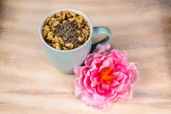 Turquoise cup of tea with flower on tray. Ready to drink Stock Photography