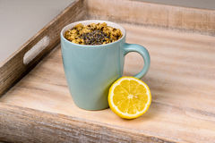 Turquoise cup of tea with lemon on tray. Ready to drink Royalty Free Stock Photography