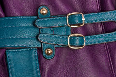 Turquoise decoration straps on violet Stock Image