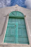 Turquoise Door. A turquoise door of a white church royalty free stock photo
