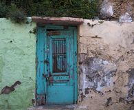 Turquoise Door With Green And Beige Walls Stock Images