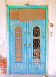The Turquoise Door. Old traditional turquoise door in an abandoned house stock photo
