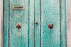 Turquoise doors with patten handles. Wonderful old doors with patten handles and mailbox Stock Photos