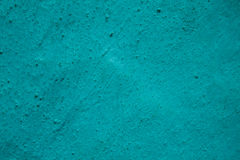 Turquoise dotted grunge textured wall. Turquoise dotted grunge texture, background Royalty Free Stock Photography