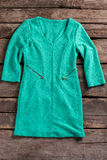 Turquoise dress with zipper pockets. Royalty Free Stock Photos