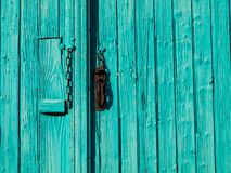 Turquoise entrance door Stock Photography