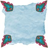 Turquoise Etoffe Designs on Torn Paper Stock Photo