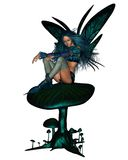 Turquoise Fairy Sitting on a Toadstool Royalty Free Stock Photo