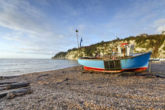 Turquoise Fishing Boat. Fishing boat on the beach at Beer in Devon Stock Photos