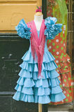 Turquoise flamenco dress is displayed in Centro old district of Sevilla Spain Stock Photography