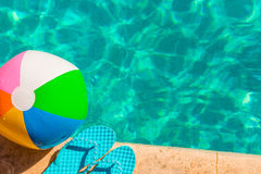 Turquoise flip flops and ball Stock Images