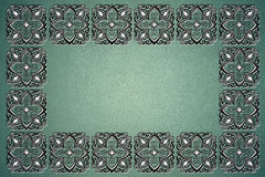 Turquoise floral frame. Turquoise background with a leather texture and floral pattern Royalty Free Stock Photography
