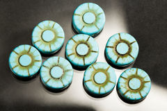 Turquoise flower shaped gems Royalty Free Stock Images