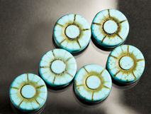 Turquoise flower shaped gems Stock Photography