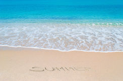 Turquoise foreshore and summer writing Royalty Free Stock Image