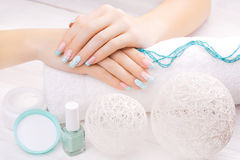 Turquoise french manicure with light towel Royalty Free Stock Photography