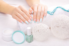 Turquoise french manicure with light towel Stock Photos