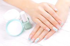 Turquoise french manicure with light towel Royalty Free Stock Images