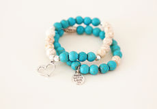 Turquoise gemstone bracelets with silver charms
