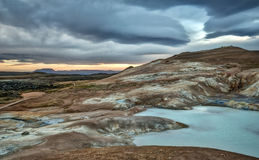 Turquoise Geothermal Hot Spring in Krafla Iceland. Turquoise Hot Spring under Cloudy Autumn Skies in the Geothermally Active Krafla Caldera of Iceland Royalty Free Stock Image