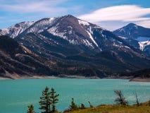 Turquoise Gibson Dam of the Sun River Montana stock photos
