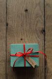 Turquoise Gift Box with Red Ribbon and Vintage Style Christmas T Royalty Free Stock Image