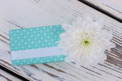 Turquoise gift box with white flower. royalty free stock photography