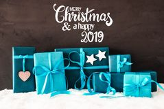 Turquoise Gifts, Calligraphy Merry Christmas And A Happy 2019 stock images