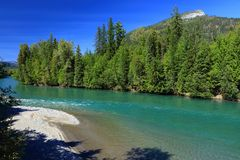 Turquoise Glacial Waters of the Kootenay River at the North End of Kootenay Lake between the Selkirk and Purcell Mountains, BC. The turquoise glacial waters of stock photo