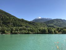 Turquoise glacier lake in alpine region. Royalty Free Stock Image