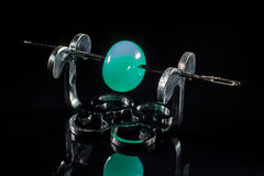 Turquoise glass bead on stand Stock Images