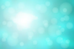 Turquoise green abstract with bokeh lights blurred background royalty free stock photo