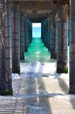 Turquoise-green Indian Ocean: Perspective under the Jetty Stock Photos