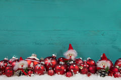 Turquoise green wooden christmas background with red balls. Royalty Free Stock Images