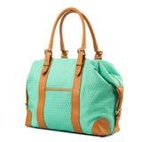 Turquoise handbag isolated on white background. Royalty Free Stock Photo