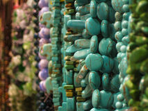 Turquoise Hanging Beads. Turquoise beaded necklace hanging among others Stock Photography
