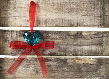 Turquoise heart on old wooden background. Turquoise heart with red ribbon on old wooden background Royalty Free Stock Images