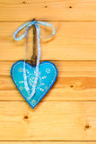 Turquoise heart on wooden wall Stock Images