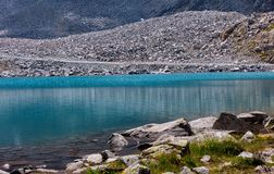 High mountain lake in the middle of the rocks Stock Images