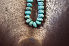 Turquoise Jewelry. On a bronze background Royalty Free Stock Image