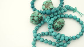 Turquoise jewelry. Necklace and bracelet with gemstones stock footage