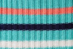Turquoise knitted background. Knitted texture. A sample of knitt. Knitted background. Knitted texture. A sample of knitting from wool. Knitting Pattern Stock Photo