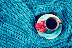Turquoise knitted woolen scarf, cup of coffee Stock Images