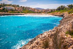 Turquoise lagoon at the coast of the Spanish island Mallorca. Turquoise lagoon at the coast of the Spanish island Mallorca in the Mediterranean Sea, Europe Royalty Free Stock Photos