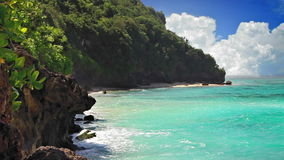 Turquoise lagoon loop. The rocky lagoon with turquoise sea and the clouds away loop stock video